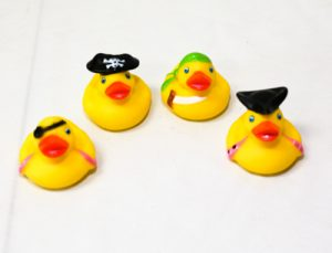 Four rubber ducks dressed as pirates