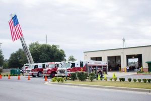 view of firetrucks in front of the Pace Fire Dept